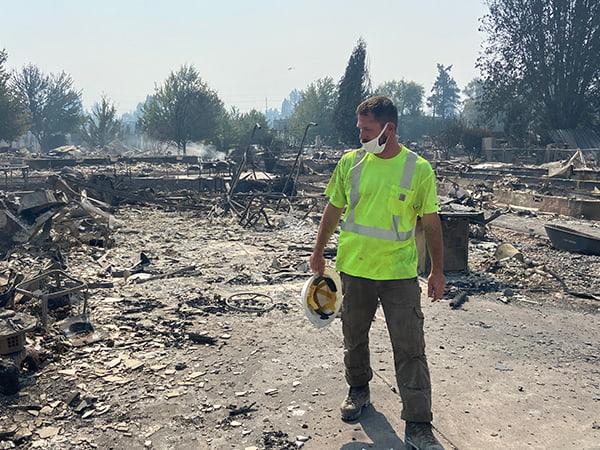 crewman assessing fire damage