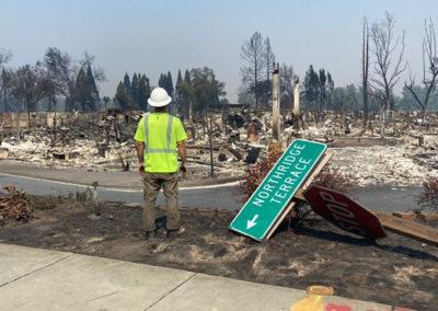 fallen street sign fire damage